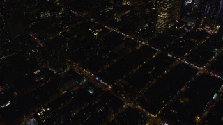 AX122_128 - 6K stock footage aerial video orbit city streets in Hell's Kitchen at Night in Midtown Manhattan, New York City