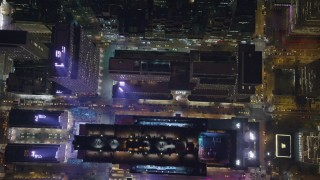 AX122_138 - 6K stock footage aerial video of a bird's eye of Rockefeller Center revealing ice rink at Night in Midtown, NYC