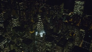 AX122_140 - 6K stock footage aerial video of orbiting top of the Chrysler Building at Night in Midtown, New York City