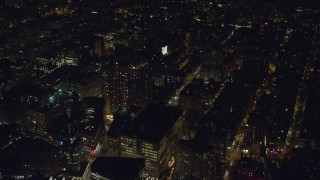AX122_145 - 6K stock footage aerial video of office buildings and Washington Square Arch at Night in Greenwich Village, NYC
