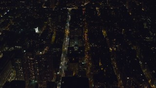 AX122_146 - 6K stock footage aerial video of city streets and apartment building near Washington Square Arch at Night, Greenwich Village, NYC