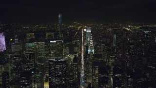 AX122_156 - 6K stock footage aerial video of Chrysler Building and Lexington Avenue at Night in Midtown, NYC