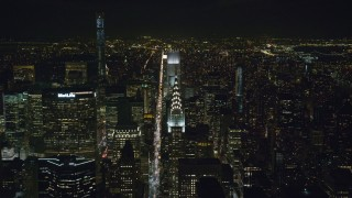 AX122_157 - 6K stock footage aerial video approach the Chrysler Building by Lexington Avenue at Night in Midtown, New York City
