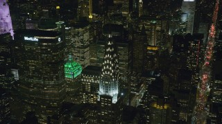 AX122_158 - 6K stock footage aerial video of orbiting the Chrysler Building at Nighttime in Midtown Manhattan, NYC