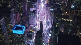 AX122_185 - 6K stock footage aerial video of heavy traffic through Times Square at Night in Midtown Manhattan, New York City