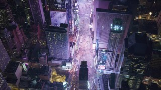 AX122_186 - 6K stock footage aerial video of heavy traffic in famous Times Square at Nighttime, Midtown Manhattan, NYC
