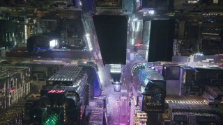 AX122_188 - 6K stock footage aerial video of a bird's eye view of Times Square at Nighttime in Midtown, NYC