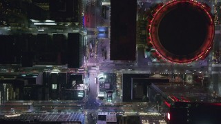 AX122_190 - 6K stock footage aerial video of a bird's eye of 7th Ave in Midtown and reveal Madison Square Garden at Night, NYC