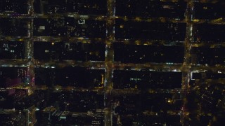 AX122_192 - 6K stock footage aerial video of a bird's eye of city streets in Chelsea, New York City at Night