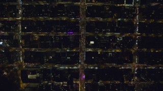AX122_193 - 6K stock footage aerial video of a bird's eye view of traffic on Chelsea streets at Night in NYC