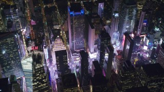 AX122_197 - 6K stock footage aerial video orbit skyscrapers around Times Square at Night in Midtown Manhattan, New York City