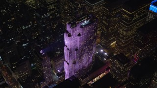 AX122_199E - 5.5K stock footage aerial video of an orbit of Rockefeller Center at Night in Midtown Manhattan, New York City