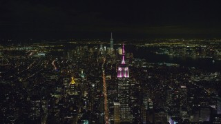 AX122_211 - 6K stock footage aerial video of the Empire State Building and Lower Manhattan at Night in New York City