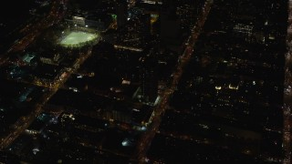 AX122_215 - 6K stock footage aerial video orbit Hell's Kitchen apartment buildings and streets at Night in Midtown, New York City