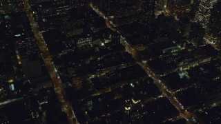 AX122_216 - 6K stock footage aerial video orbit Hell's Kitchen streets and apartments at Night in Midtown Manhattan, New York City