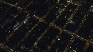AX122_217 - 6K stock footage aerial video of orbiting Hell's Kitchen streets at Night in Midtown, New York City