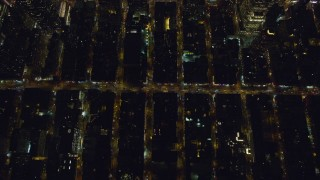 AX122_218 - 6K stock footage aerial video of a bird's eye of Hell's Kitchen streets at Night in Midtown Manhattan, New York City