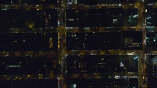 AX122_219 - 6K stock footage aerial video bird's eye view of Hell's Kitchen streets at Night in Midtown Manhattan, New York City