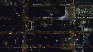 AX122_220 - 6K stock footage aerial video of a bird's eye view of traffic on Hell's Kitchen streets at Night in Midtown, New York City