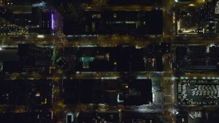 AX122_221 - 6K stock footage aerial video of a bird's eye of city streets in Hell's Kitchen at Night in Midtown, New York City