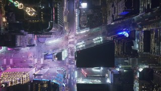 AX122_224 - 6K stock footage aerial video of a bird's eye view of 42nd Street revealing Times Square at Night, Midtown Manhattan, NYC