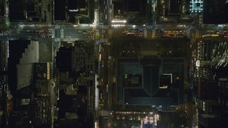 AX122_226 - 6K stock footage aerial video of bird's eye of 42nd Street and Bryant Park at Night in Midtown, New York City