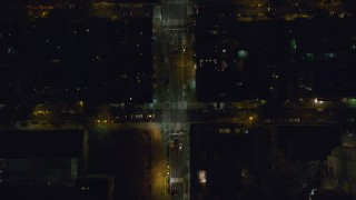 AX122_232 - 6K stock footage aerial video of a bird's eye of 2nd Avenue through Gramercy at Night in NYC