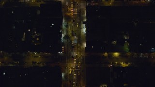 AX122_236 - 6K stock footage aerial video of a bird's eye of traffic on 2nd Street in East Village at Night in NYC