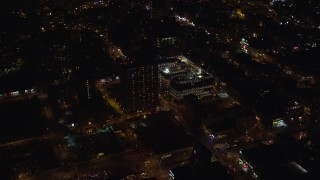 AX122_240 - 6K stock footage aerial video orbit high school and apartment building on Lower East Side at Night, New York City