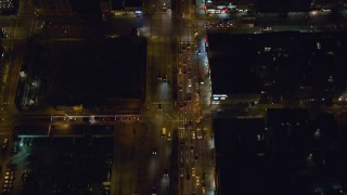 AX122_242 - 6K stock footage aerial video of a bird's eye of heavy traffic off Williamsburg Bridge to Delancey Street at Night, Lower East Side, NYC
