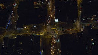 AX122_244 - 6K stock footage aerial video of a bird's eye of Delancey Street through Lower East Side at Night, New York City
