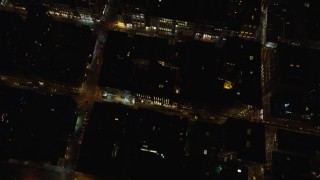 AX122_245 - 6K stock footage aerial video of a bird's eye of Kenmare Street and stores at Night in Soho, New York City