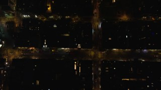 AX122_246 - 6K stock footage aerial video of a bird's eye of city streets at Night in Soho, NYC