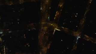 AX122_247 - 6K stock footage aerial video of a bird's eye view of Avenue of the Americas at Night in Soho, New York City