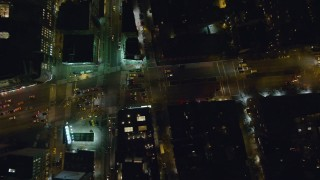 AX122_250 - 6K stock footage aerial video of bird's eye view of cars on Houston Street in Soho at Night in New York City