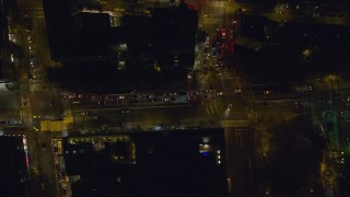 AX122_251 - 6K stock footage aerial video of a bird's eye of Houston Street in Soho at Night in New York City