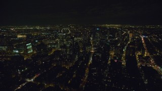 AX122_264 - 6K stock footage aerial video of orbiting towers in downtown area of Brooklyn at Night in New York City