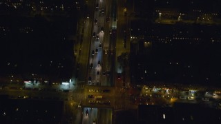 AX122_267 - 6K stock footage aerial video of a bird's eye of cars on the Brooklyn Queens Freeway at Nighttime in New York City