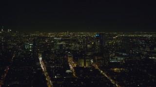 AX122_268 - 6K stock footage aerial video of orbiting skyscrapers in Brooklyn at Night in NYC