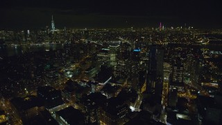 AX122_272 - 6K stock footage aerial video of circling Brooklyn high-rises at Night in New York City with Manhattan in the distance