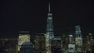 AX122_287 - 6K stock footage aerial video of an orbit of Freedom Tower at Night in Lower Manhattan, NYC