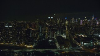 AX123_013 - 6K stock footage aerial video of Midtown Manhattan and Upper West Side skyscrapers at Night in New York City