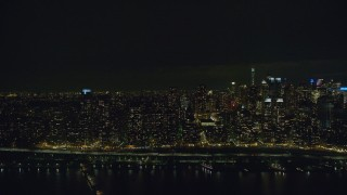 AX123_015 - 6K stock footage aerial video of flying by Upper West Side skyscrapers at Night in New York City