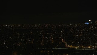 AX123_016 - 6K stock footage aerial video of passing Upper West Side high-rises at Night in New York City