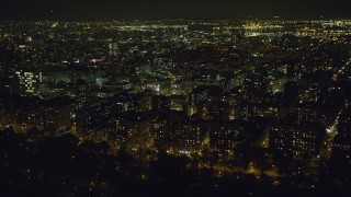 AX123_021 - 6K stock footage aerial video approach Columbia University at Night in New York City