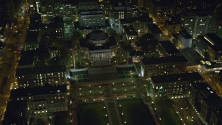 AX123_023 - 6K stock footage aerial video orbit the library at Columbia University at Night in NYC