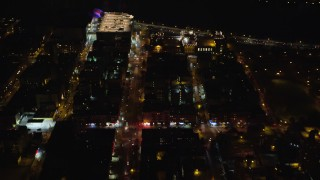AX123_026 - 6K stock footage aerial video fly over Harlem streets and apartment buildings at Night in NYC