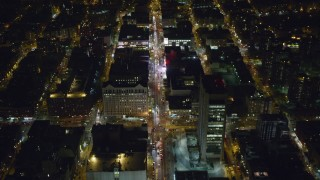 AX123_035 - 6K stock footage aerial video fly over Harlem office buildings on 125th Street at Night, New York City