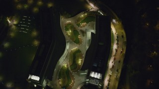 AX123_045 - 6K stock footage aerial video of a bird's eye orbit of modern office complex in Harlem at Night in New York City