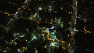 AX123_048 - 6K stock footage aerial video tilt to bird's eye of public housing complex in Harlem at Night, New York City